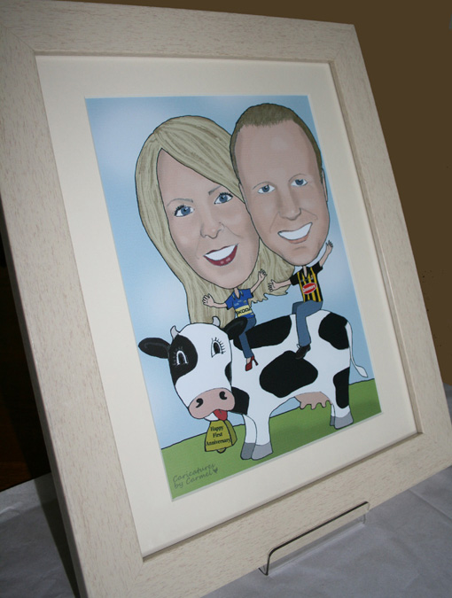 Framed Caricature of a couple sitting on a cow.