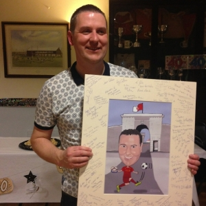 John celebrating his 40th Birthday with a Caricatures by Carmel Caricature Guest Signing Board