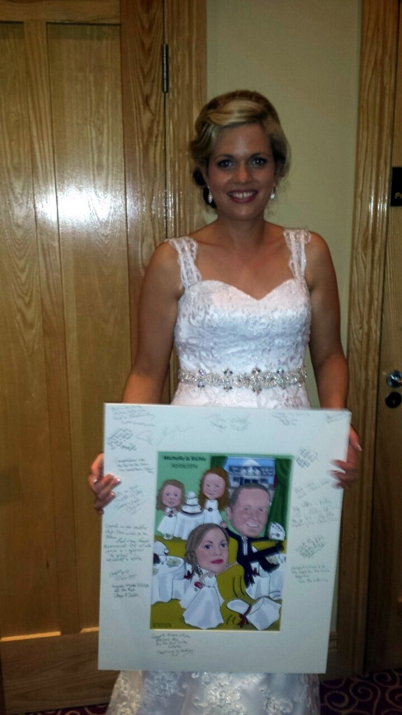 Bride with her signed caricature wedding guest signing board
